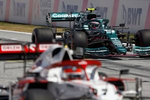 Kimi Raikkonen, Alfa Romeo Racing C41, and Sebastian Vettel, Aston Martin AMR21, practice their race start procedures at the end of FP3