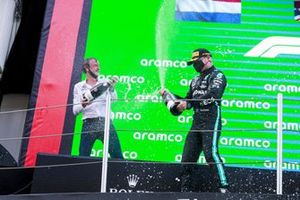 Valtteri Bottas, Mercedes, 3rd position, sprays the Mercedes trophy delegate with Champagne on the podium