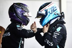 Lewis Hamilton, Mercedes, 1st position, and Valtteri Bottas, Mercedes, 3rd position, congratulate each other in Parc Ferme
