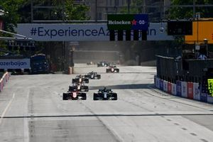 Lewis Hamilton, Mercedes W12, passes Charles Leclerc, Ferrari SF21