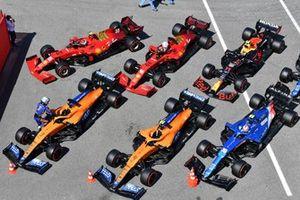 The cars of Daniel Ricciardo, McLaren MCL35M, Lando Norris, McLaren MCL35M, Esteban Ocon, Alpine A521, Carlos Sainz Jr., Ferrari SF21, Charles Leclerc, Ferrari SF21, Sergio Perez, Red Bull Racing RB16B, and Fernando Alonso, Alpine A521, in Parc Ferme