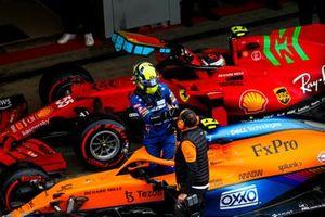 Pole man Lando Norris, McLaren, celebrates with a team mate in Parc Ferme