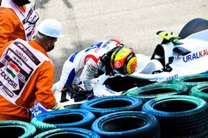 Marshals assist Mick Schumacher, Haas F1, after his crash in FP3