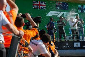 Daniel Ricciardo, McLaren, 1st position, Valtteri Bottas, Mercedes, 3rd position, and Lando Norris, McLaren, 2nd position, spray Zak Brown, CEO, McLaren Racing, with Champagne on the podium