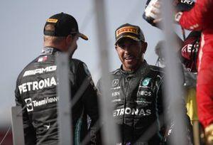 Valtteri Bottas, Mercedes, 3rd position, and Lewis Hamilton, Mercedes, 1st position, talk on the podium