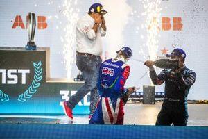 Alex Lynn, Mahindra Racing, 1st position, Mitch Evans, Jaguar Racing, 3rd position, spray Champagne on the podium