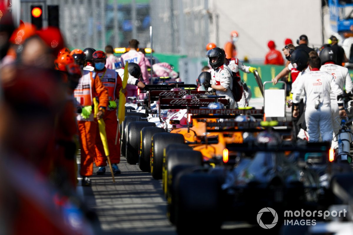 The cars in the pits