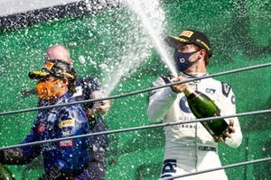 Carlos Sainz Jr., McLaren , 2nd position, and Pierre Gasly, AlphaTauri, 1st position, spray Champagne from the podium