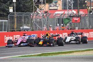 Alex Albon, Red Bull Racing RB16, battles with Sergio Perez, Racing Point RP20, and Daniil Kvyat, AlphaTauri AT01