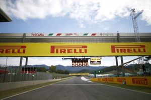 The pit light gantry over the pit straight, including Pirelli branding over a bridge