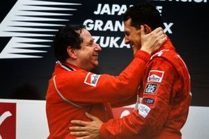 Jean Todt, Team Principal, Ferrari, and Michael Schumacher, 1st position, on the podium