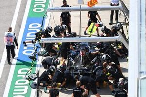 The Mercedes pit crew work on the car of Lewis Hamilton, Mercedes F1 W11