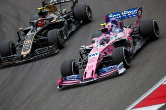 Lance Stroll, Racing Point RP19, leads Kevin Magnussen, Haas F1 Team VF-19