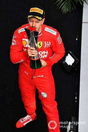 Sebastian Vettel, Ferrari, 3rd position, kisses his trophy