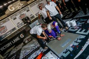 Denny Hamlin, Joe Gibbs Racing, Toyota Camry FedEx Express leaves his hand and foot prints in cement after winning the Daytona 500