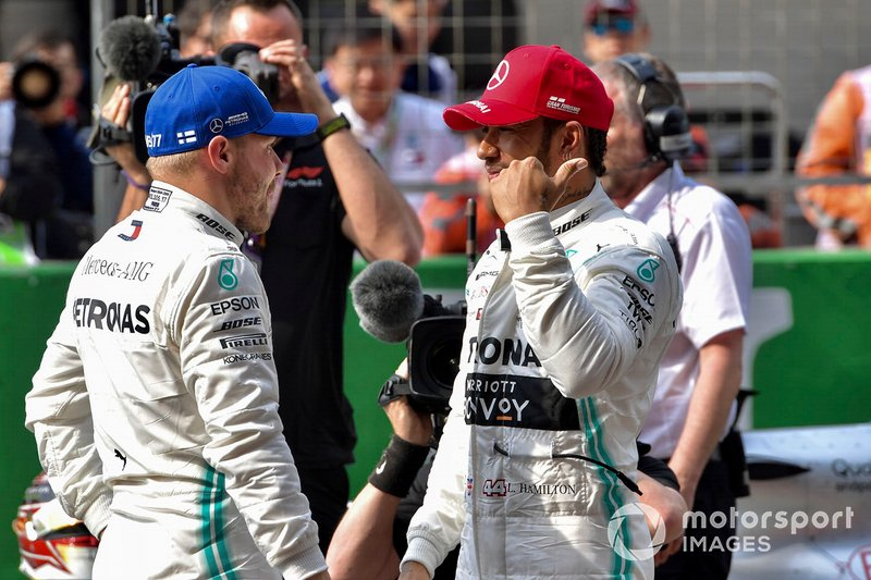 Front row starters Valtteri Bottas, Mercedes AMG F1, and Lewis Hamilton, Mercedes AMG F1, on the grid