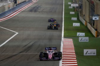 Sergio Perez, Racing Point RP19, leads Kevin Magnussen, Haas F1 Team VF-19, and Pierre Gasly, Red Bull Racing RB15
