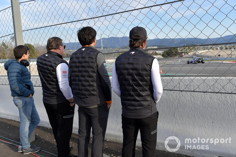 Zak Brown, McLaren Racing CEO, Carlos Sainz Jr., McLaren and Fernando Alonso watch the action trackside