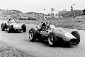 Mike Hawthorn, Ferrari Dino 246 leads Jean Behra, BRM P25