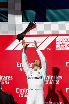 Valtteri Bottas, Mercedes AMG F1, 1st position, tosses his trophy in the air in celebration on the podium