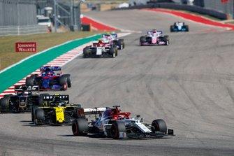 Kimi Raikkonen, Alfa Romeo Racing C38, leads Nico Hulkenberg, Renault R.S. 19, Romain Grosjean, Haas VF-19, and Daniil Kvyat, Toro Rosso STR14