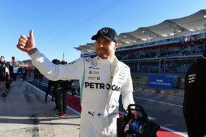 Valtteri Bottas, Mercedes AMG W10, celebrates after taking Pole Position