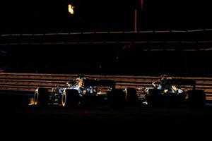 Lewis Hamilton, Mercedes AMG F1 W10, passes Kevin Magnussen, Haas F1 Team VF-19