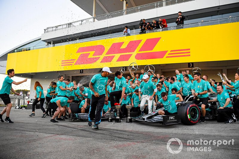 The Mercedes team celebrates victory in the Constructors Championship