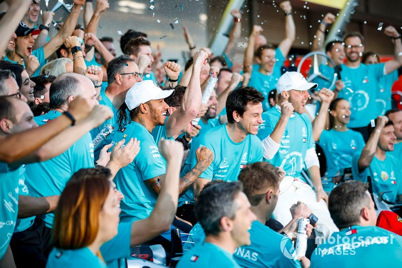 Valtteri Bottas, Mercedes AMG F1, 1st position, Lewis Hamilton, Mercedes AMG F1, 3rd position, and the Mercedes team celebrate after securing a win in the race and in the 2019 Constructors Championship
