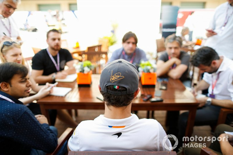 Lando Norris, McLaren, talks to the media