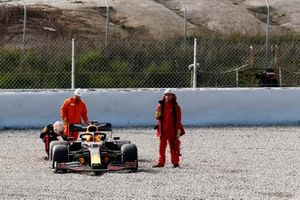 Max Verstappen, Red Bull Racing RB16, inspects his car after spinning into the gravel