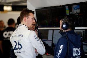 Daniil Kvyat, AlphaTauri talks with a member of his team in the garage