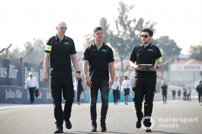 James Calado, Jaguar Racing walks the track with members of his team