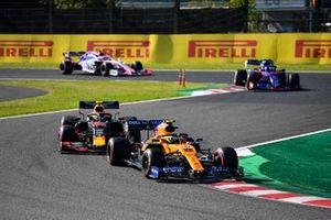 Lando Norris, McLaren MCL34, leads Alex Albon, Red Bull RB15, Pierre Gasly, Toro Rosso STR14, and Lance Stroll, Racing Point RP19