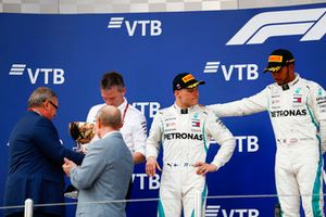 Race winner Lewis Hamilton, Mercedes AMG F1, second place Valtteri Bottas, Mercedes AMG F1, on the podium with James Allison, Technical Director, Mercedes AMG, receives the Constructors trophy from Andrey Kostin, President and Chairman of the Management Board of VTB Bank