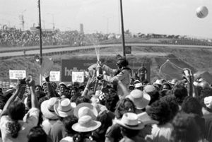 Winner Emerson Fittipaldi celebrates with his adoring fans
