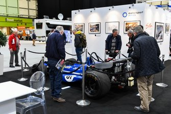 Visitors admire the 1970 March 701, driven by Jackie Stewart, on the Motorsport Images stand