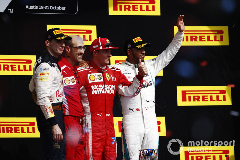 Kimi Raikkonen, Ferrari, celebrates on the podium after winning the race with Max Verstappen, Red Bull Racing, Carlos Santi, Race Engineer, Ferrari, and Lewis Hamilton, Mercedes AMG F1