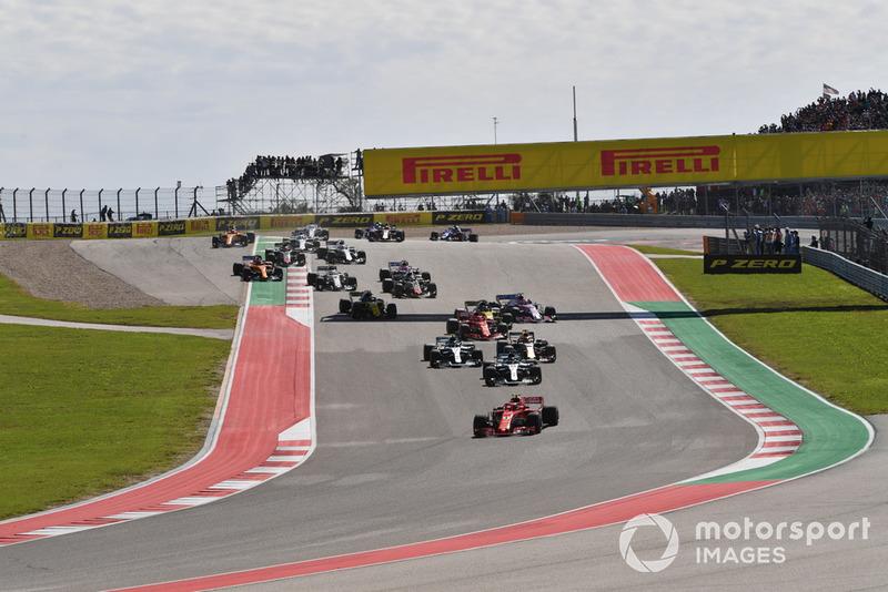 Kimi Raikkonen, Ferrari SF71H leads at the start of the race