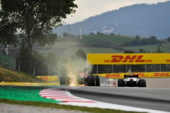 Sparks fly from Max Verstappen, Red Bull Racing RB15
