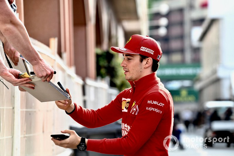 Charles Leclerc, Ferrari signs an autograph for a fan