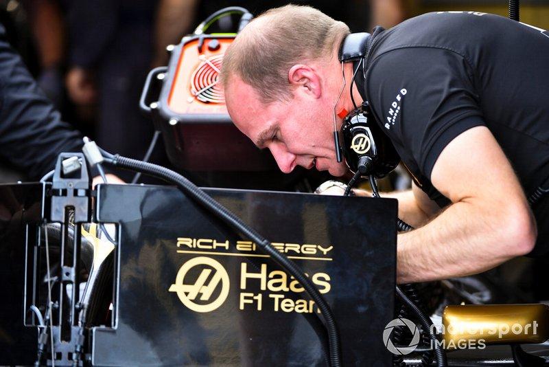 A Haas F1 mechanic at work