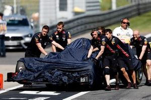 Car of Max Verstappen, Red Bull Racing RB15 being pushed down the pit lane by Re Bull Racing Mechanics after his crash