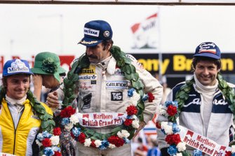Winner Clay Regazzoni on the podium with René Arnoux, 2nd position, and Jean-Pierre Jarier, 3rd position