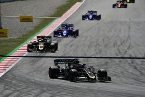 Romain Grosjean, Haas F1 Team VF-19, leads Kevin Magnussen, Haas F1 Team VF-19, Daniil Kvyat, Toro Rosso STR14, and Alexander Albon, Toro Rosso STR14