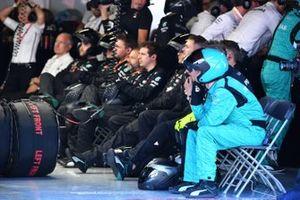 The Mercedes pit crew rest between stops
