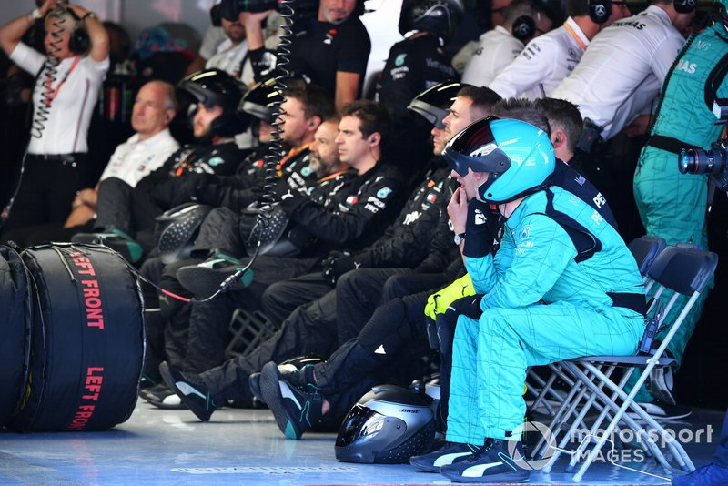 The Mercedes pit crew rest between stops