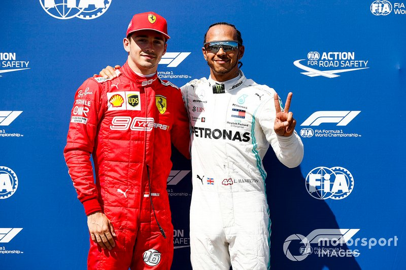 Charles Leclerc, Ferrari and Pole Sitter Lewis Hamilton, Mercedes AMG F1 celebrate in Parc Ferme