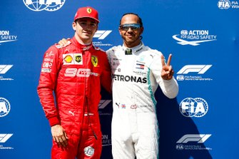 Charles Leclerc, Ferrari and Pole Sitter Lewis Hamilton, Mercedes AMG F1 celebrate in Parc Ferme