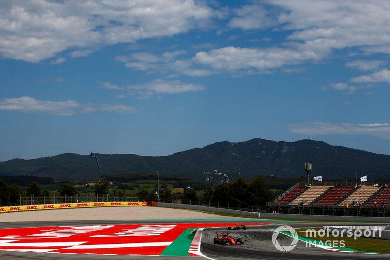 Sebastian Vettel, Ferrari SF90, devant Carlos Sainz Jr., McLaren MCL34
